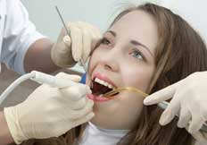 Woman Getting Teeth Cleaning